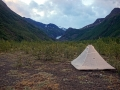 Tent pitched on the river bank