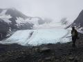 Joey walking in front of Raven Glacier