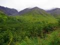 Green mountains belows Crow Pass